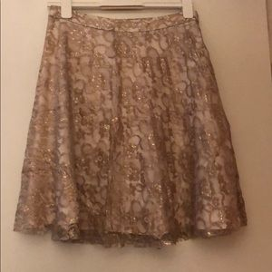Gold lace floral mid length skirt!